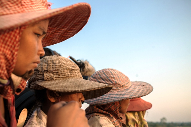 A group of Cambodian farmers in Koh Kong Province. Human rights groups report that more than 12,000 people have been forced off their land to make way for the production of sugarcane