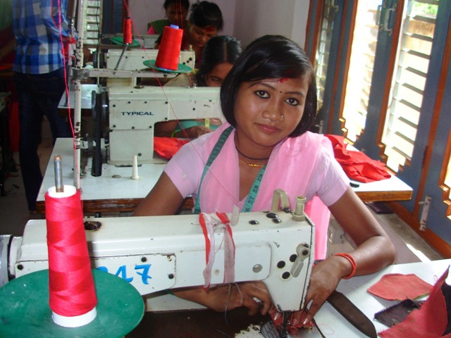 A young Tharu girl training in garment manufacturing is hopeful of a new job and a life. Many of Nepal's kamlari, or indentured female servants, are working for a better future