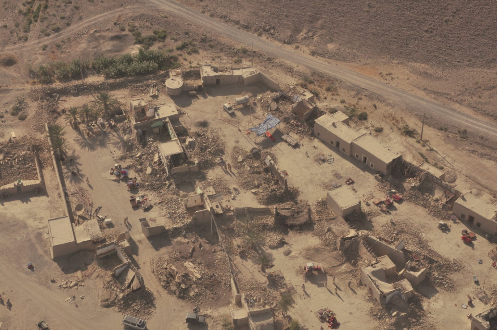 An aerial view of settlements destroyed by a magnitude 7.7 earthquake in Pakistan's Balochistan province, Awaran district. Hundreds of people were killed; 21,000 houses were completely destroyed; and more than 300,000 people were affected