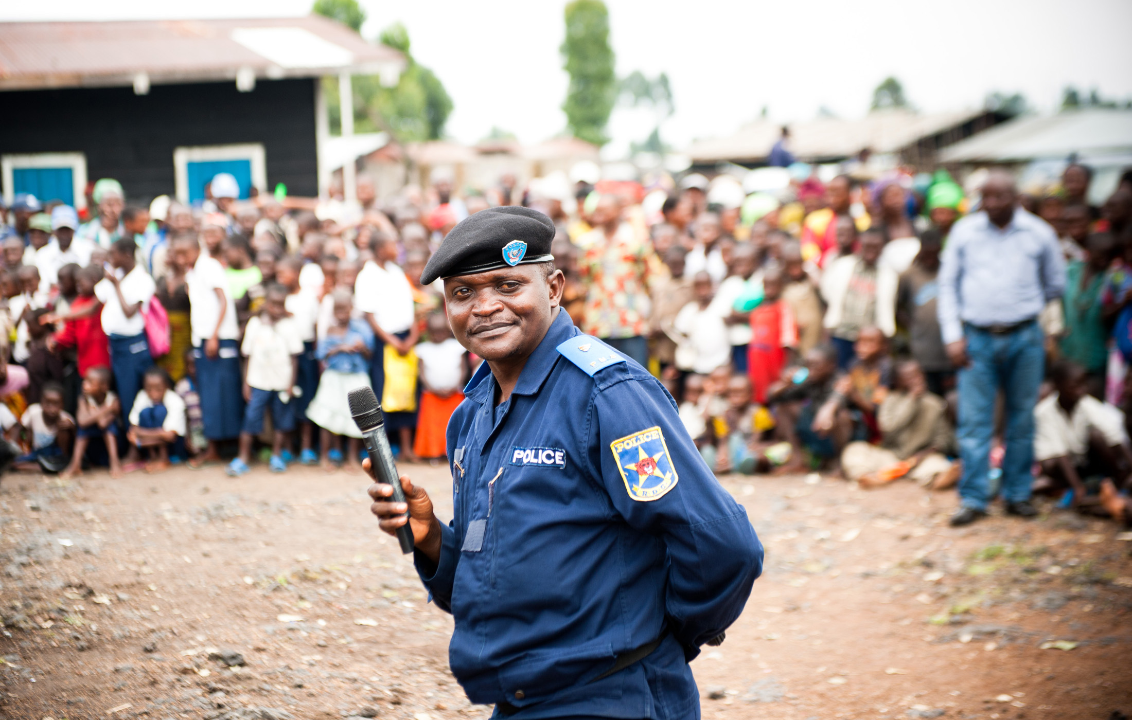 Police Major David Bodeli tells the population of Kanyaruchinya, DRC that the increased police presence is there to restore normalcy and increase security, especially in relation to sexual violence, on 28 Sept. 2013