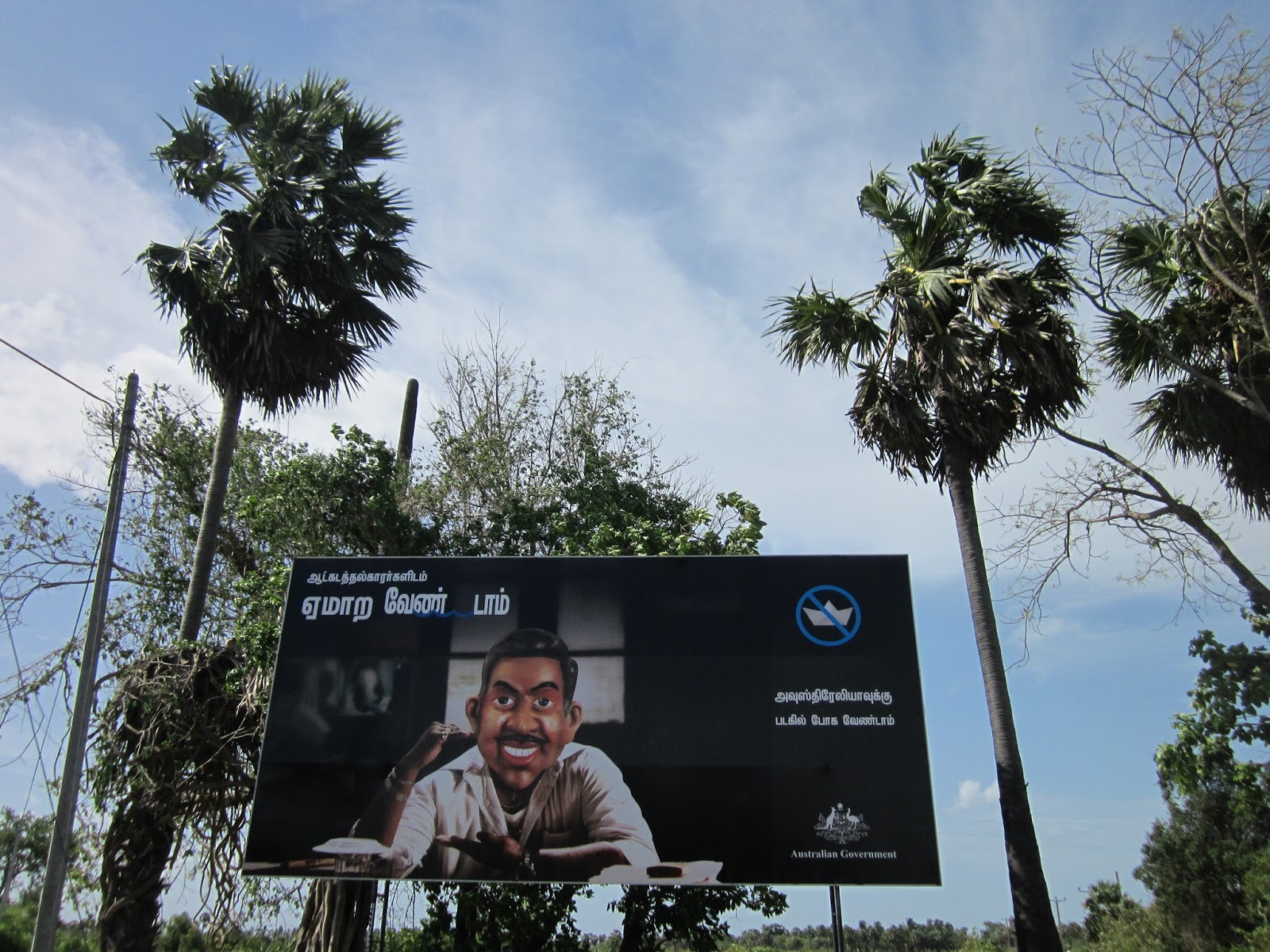 """Don't be led by illegal boat operators"" warns a government billboard in the country's eastern Batticaloa District from where young migrants have headed to sea, a perilous and potentially fatal passage"