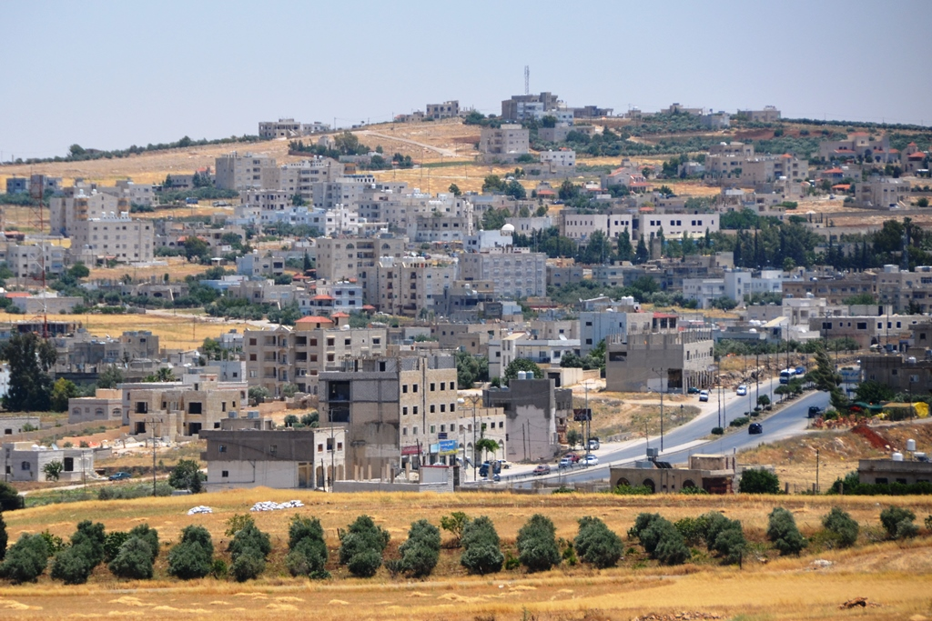A view of a Jordanian town on route from the capital Amman to the northern town of Irbid. Two-thirds of Syrian refugees in Jordan live outside the camps, in towns and cities, straining basic services and infrastructure