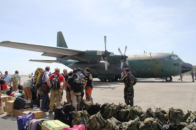 C-130 cargo plane lands in badly affected Tacloban City in the wake of Typhoon Haiyan