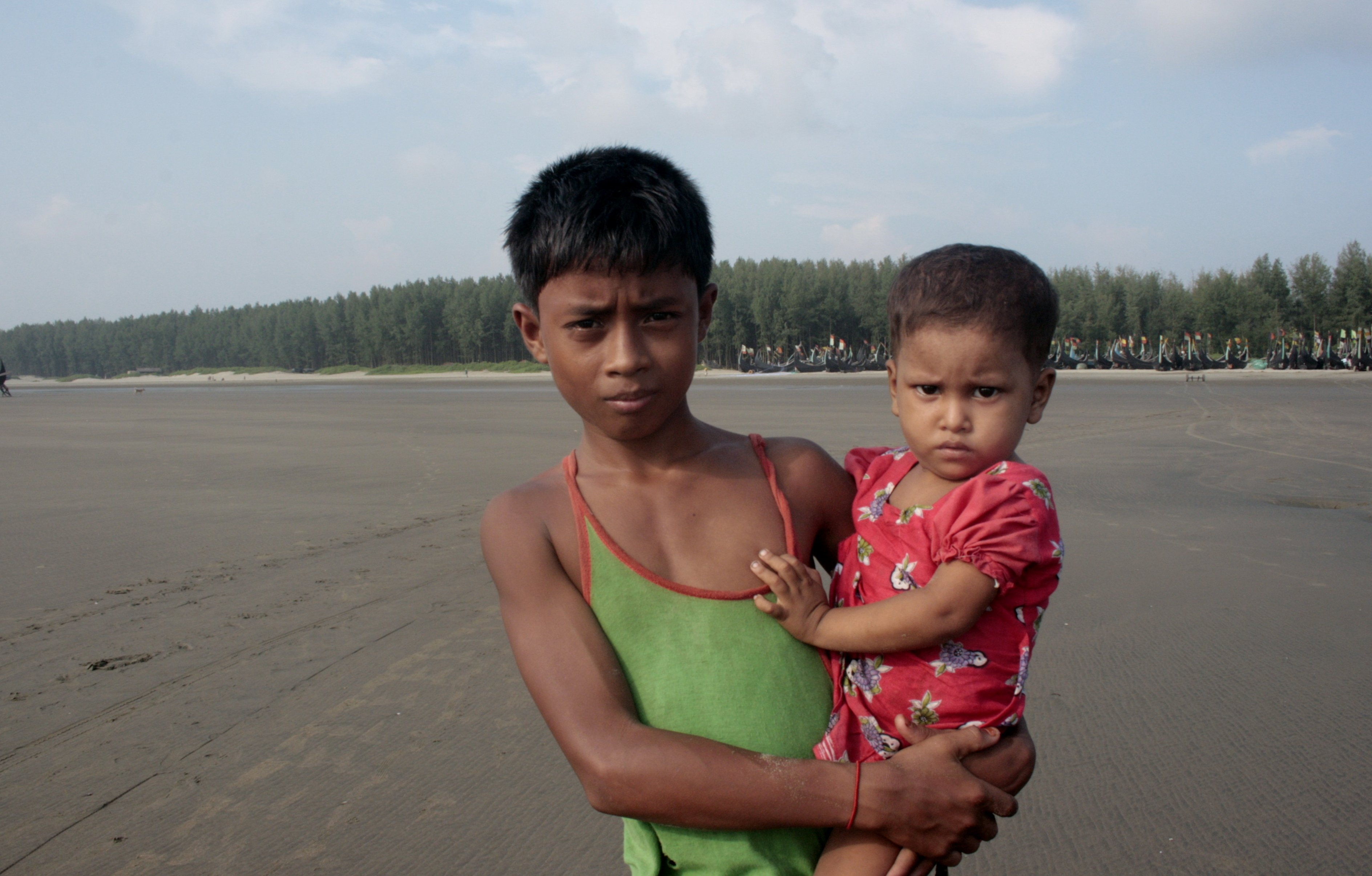 A young Rohingya boy holds his brother in Cox's Bazar. There are more than 200,000 Rohingya refugees in Bangladesh