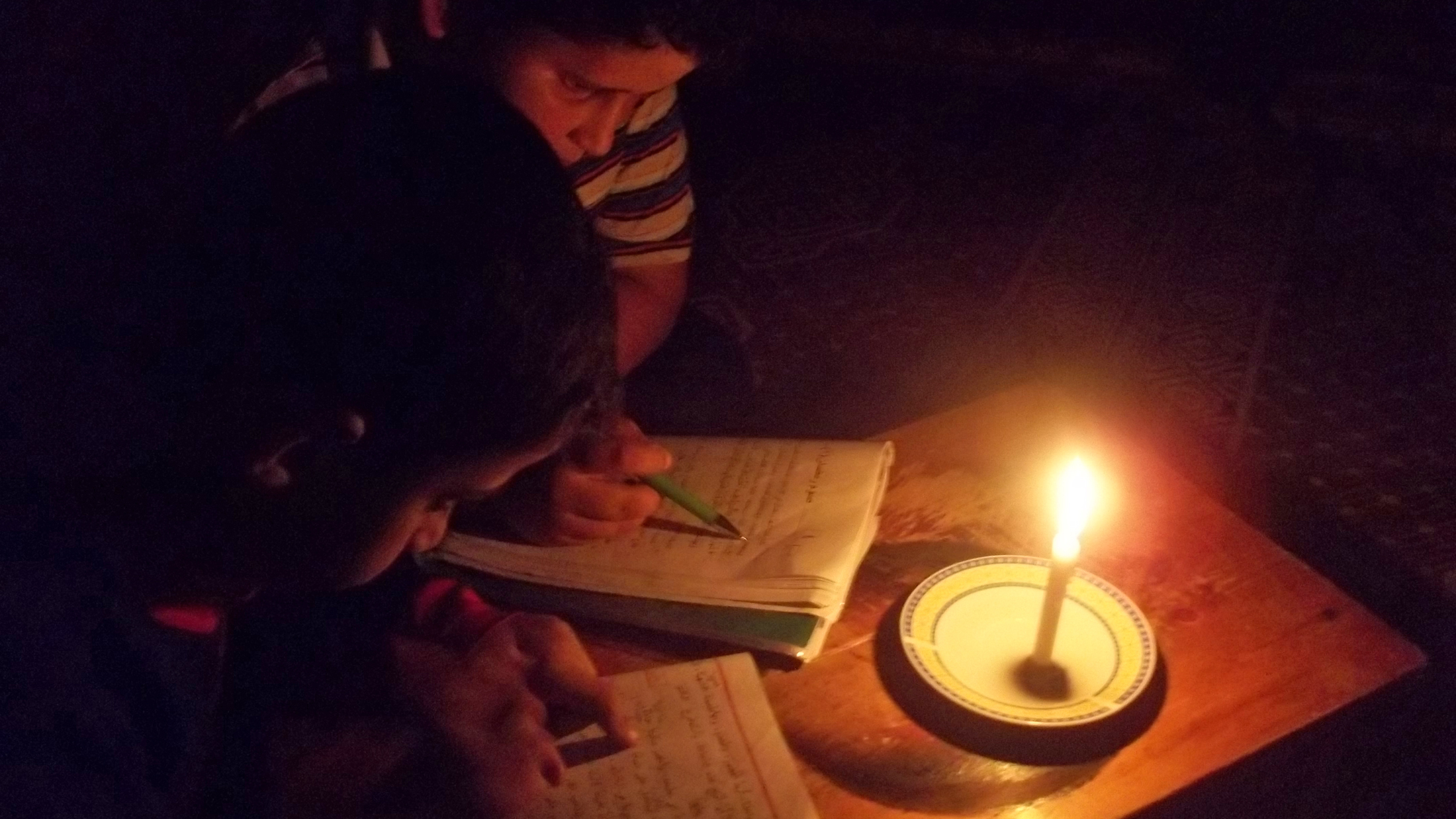 Yusri and his brother find it very exhausting to read with candle light