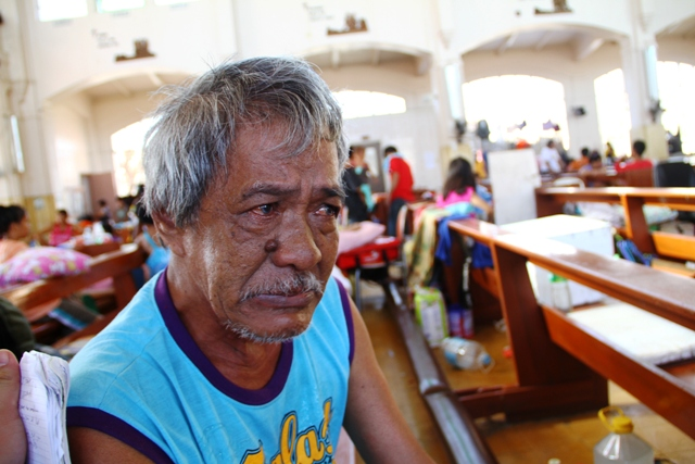 70-year-old Rodolfo Susaya, lost both his wife and daughter to Typhoon Haiyan, which struck the central Philippines on 8 November 2013. Alone, he wonders how he will be survive on his own; a common sentiment raised by many elderly residents impacted by th