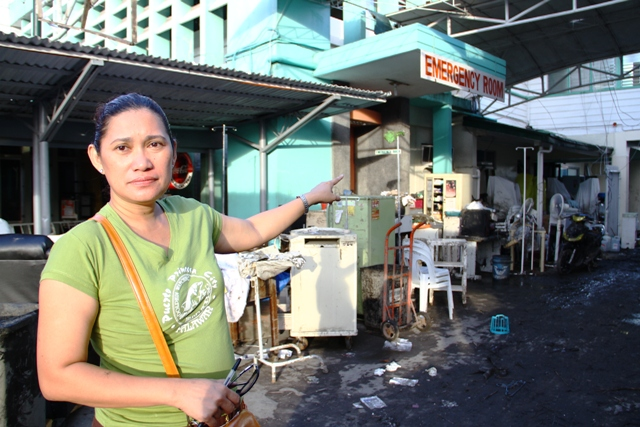 Dr Marife Garfin points to a destroyed emergency room and facilities of the Bethany Hospital in Tacloban City in the wake of Typhoon Haiyan, which struck the central Philippines on 8 November 2013