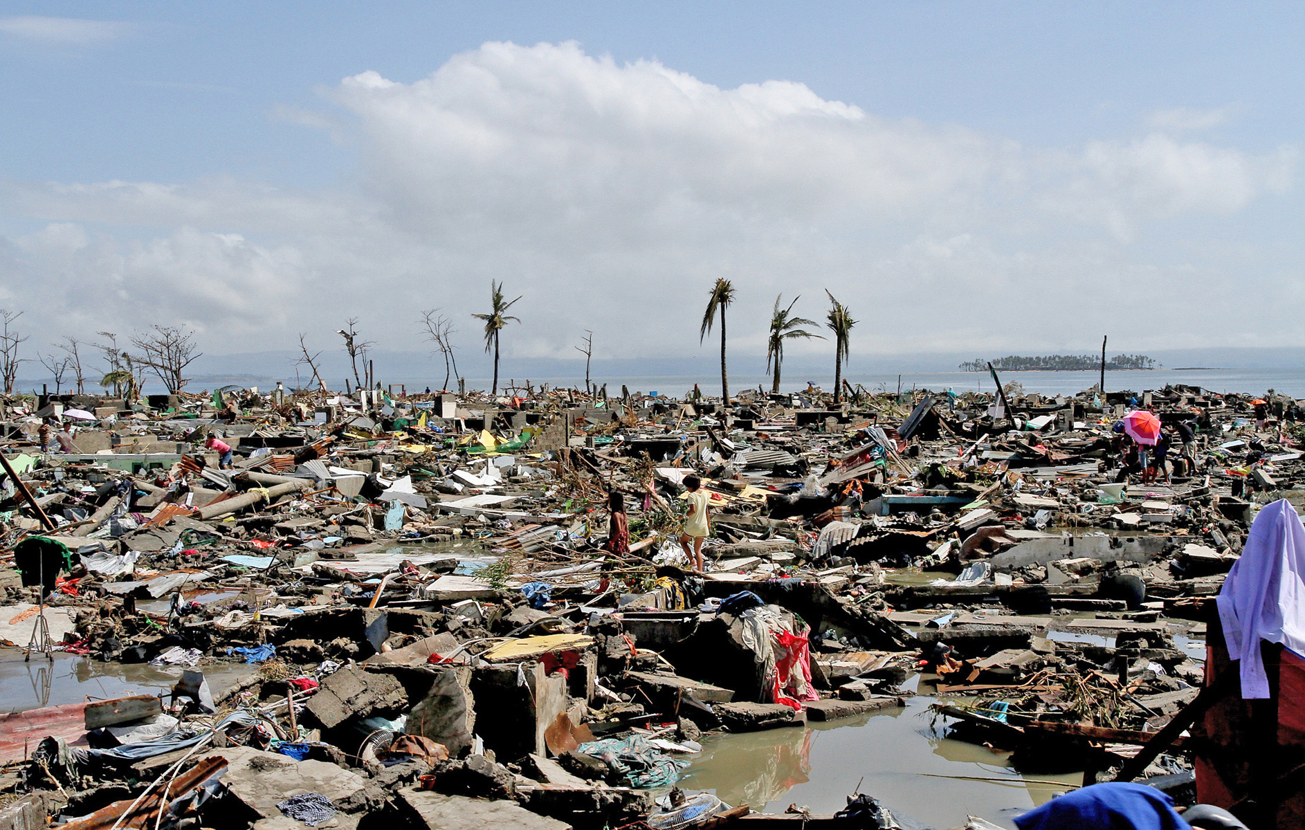 Mass devastation in the wake of Typhoon Haiyan, which struck the central Philippines, on 8 November impacting over 13 million and leaving 4 million displaced