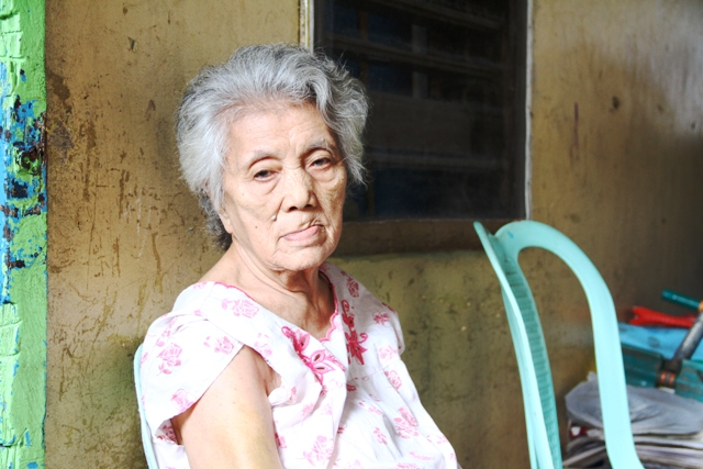 Carmela Calderon,81, a resident of Tacloban city, which was badly affected by Typhoon Haiyan on 8 November, 2013. Millions were affected by the category 5 storm