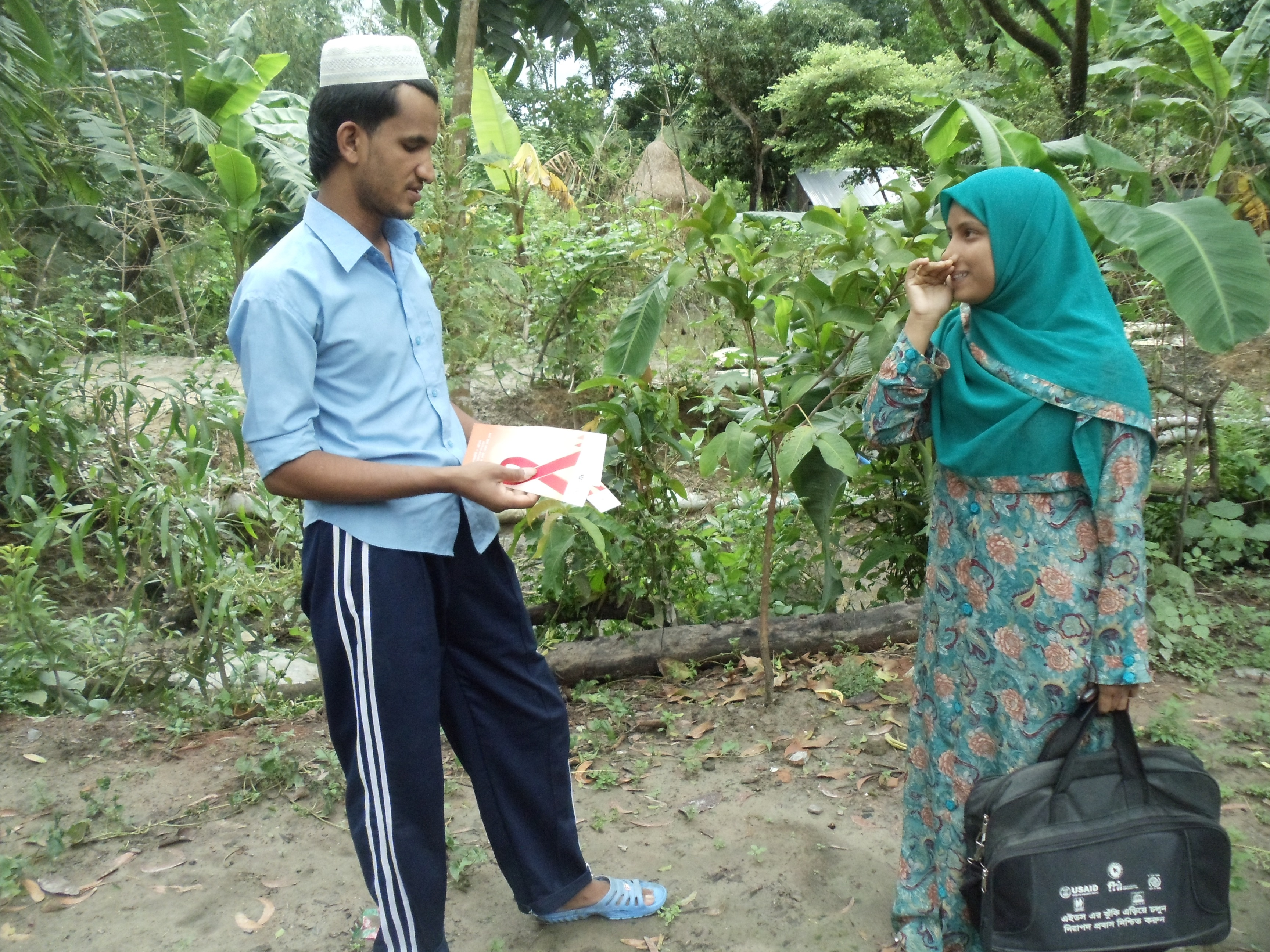 An HIV outreach worker reaches out to returning Bangladeshi migrant workers