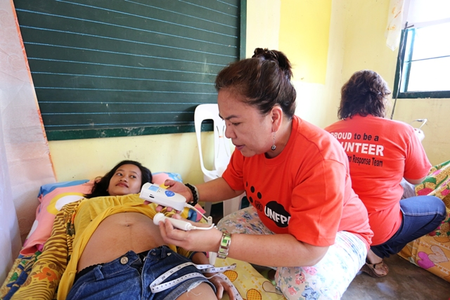 Maternal health care after disasters tends to come too little, too late. In the aftermath of Typhoon Haiyan, experts estimate some 300,000 pregnant women are in need of care. This woman is receiving care in Tacloban.