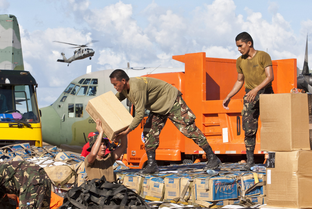 Members of the Philippine military load relief goods at Tacloban's airport