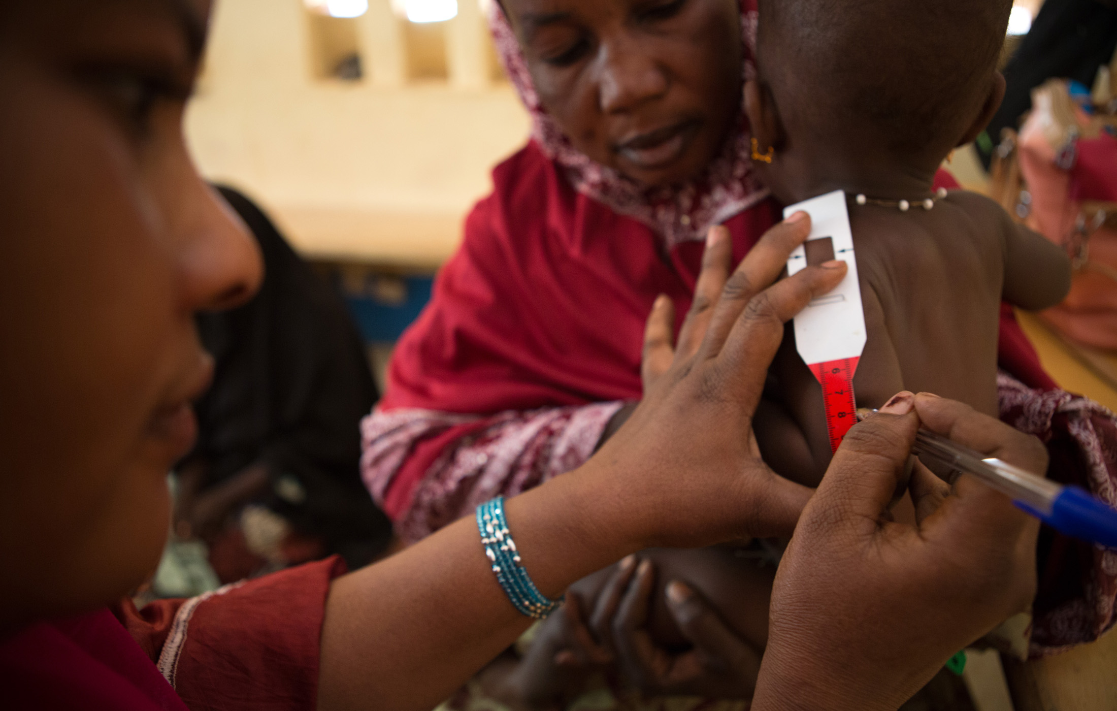 A nurse records a child's weight and height during a consultation at the referral health center in Gao, Mali.  WFP, in partnership with Action Contre la Faim (ACF), provide consultations, care and medication to malnourished children and pregnant women i