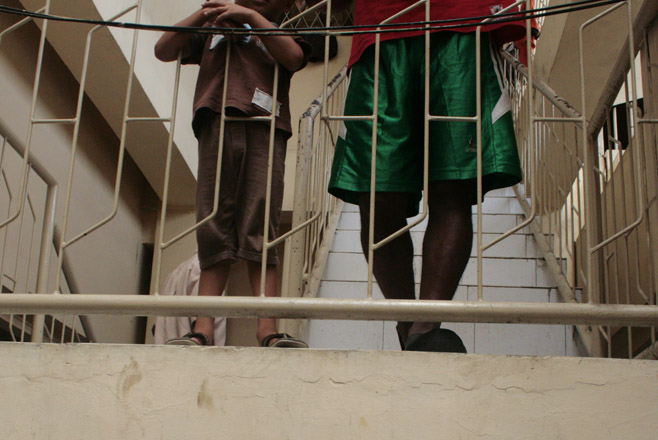 Two asylum-seeking boys stand on a staircase while detained at Belawan Immigration Detention Center in September 2012