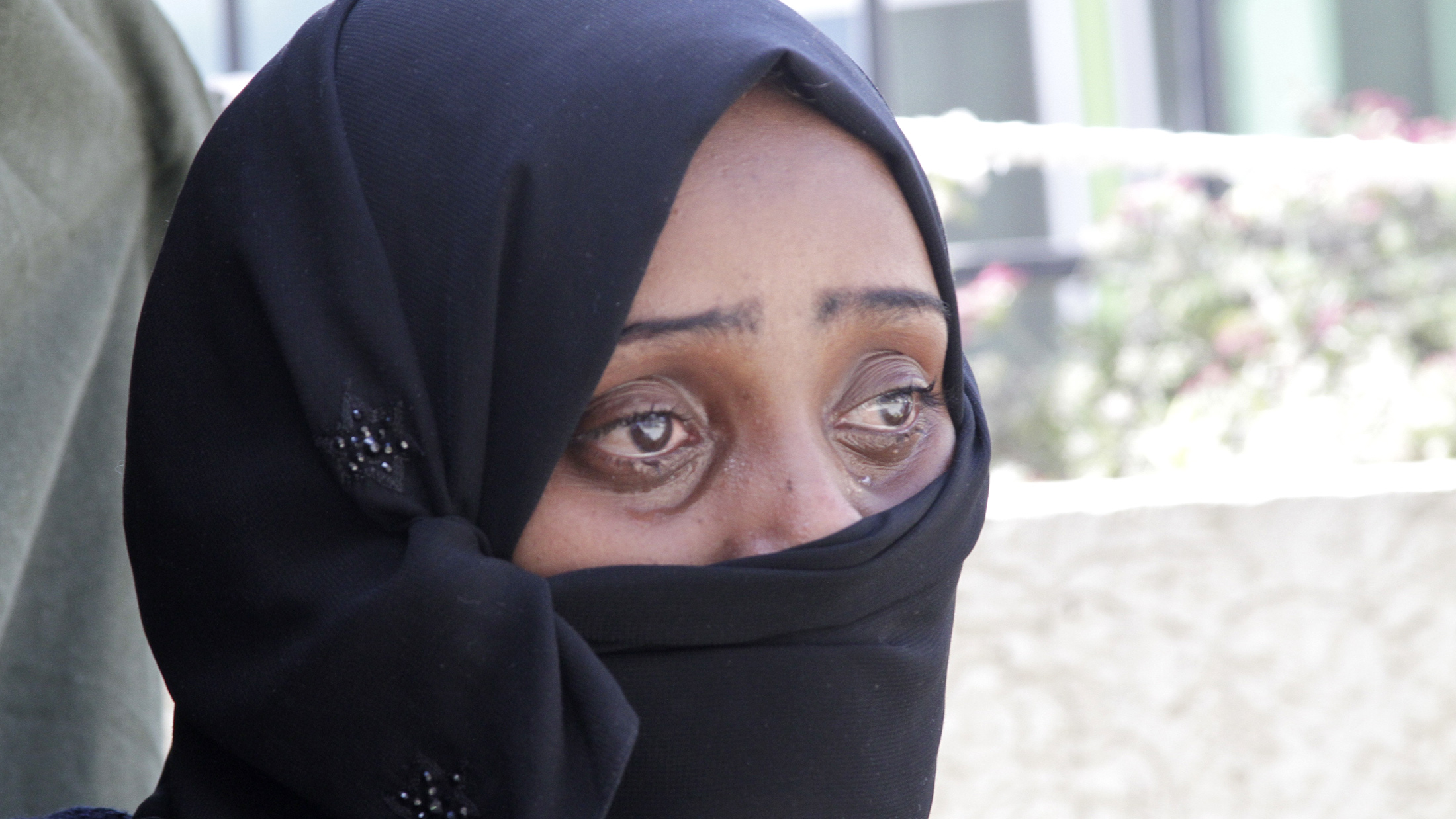 An Ethiopian migrant shortly after arriving at the airport in Addis Ababa following her arrest and detention in Saudi Arabia for working without documents