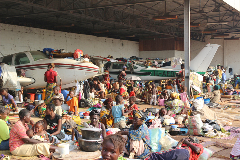 Displaced people taking refuge in hangars where old planes are stored at Bangui M'Poko International Airport, located 7 km northwest of Bangui, the capital of the Central African Republic. An estimated 108,000 people were staying in 30 locations across Ba