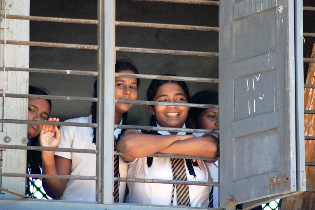 A group of school girls look to the camera in Colombo