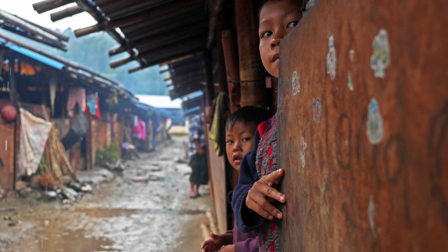 Two children look to the camera at an IDP camp in Myanmar's northern Kachin State. More than two years since fighting erupted, more than 100,000 people remain displaced