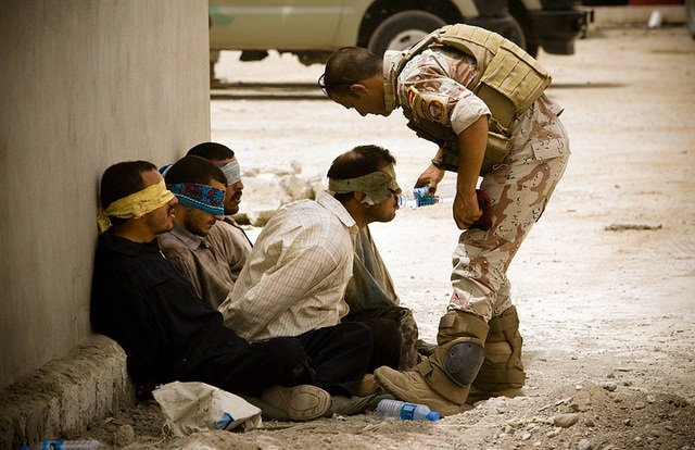 An Iraqi Army soldier guards detainees during a patrol in Ramadi, 2011