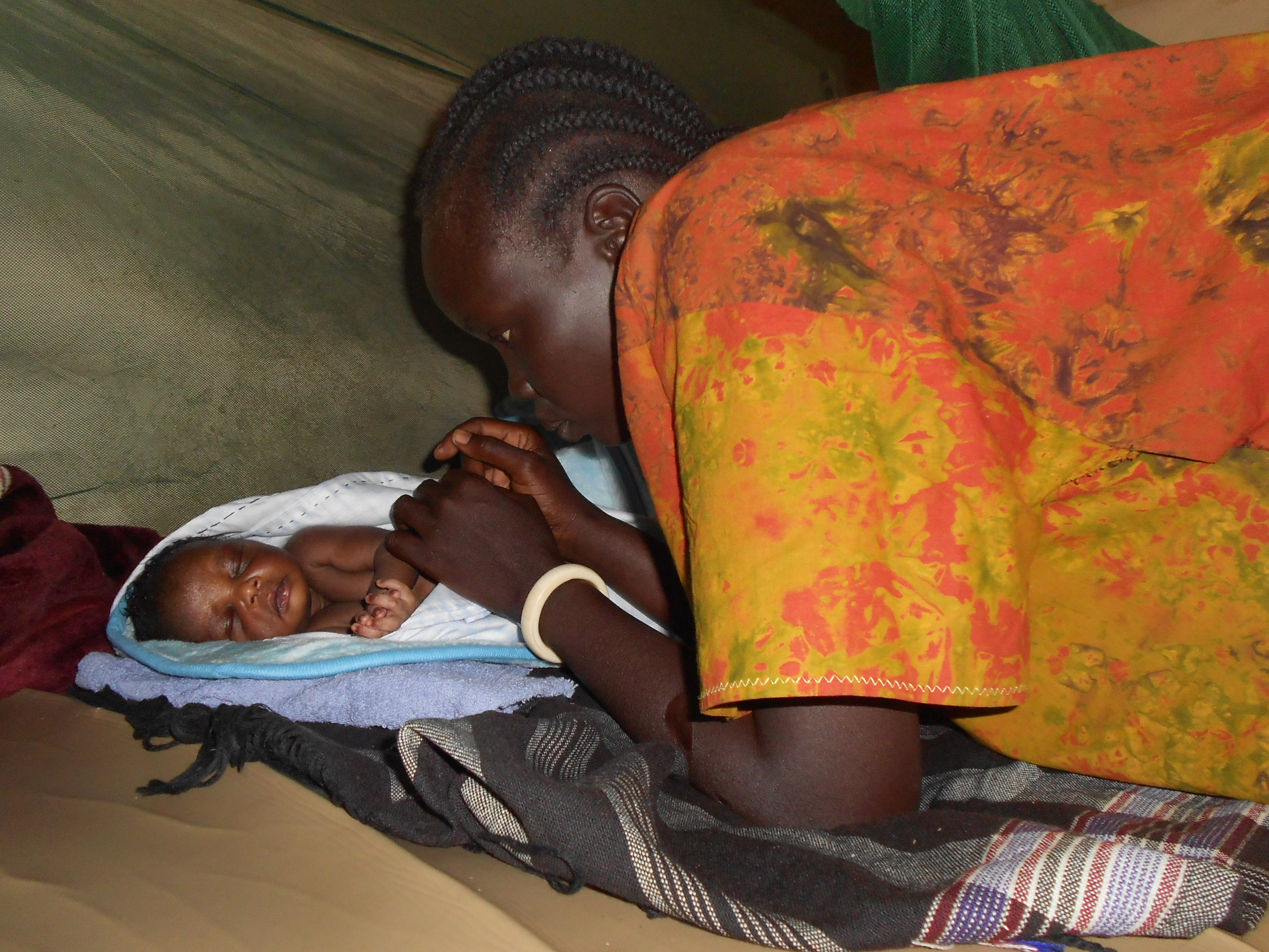 Martha Anger with her baby at the Nzjapi health centre III. She gave birth four days after fleeing into Uganda to avoid being caught up in the raging  conflict in South Sudan, which has so far left some 355,000 people displaced and hundreds dead.