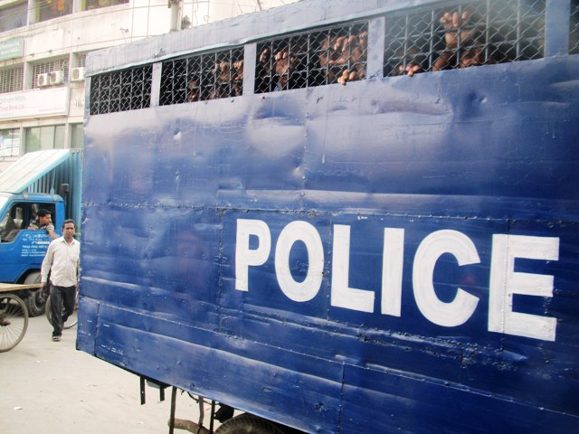Let me out, say occupants of this police van on the streets of Dhaka