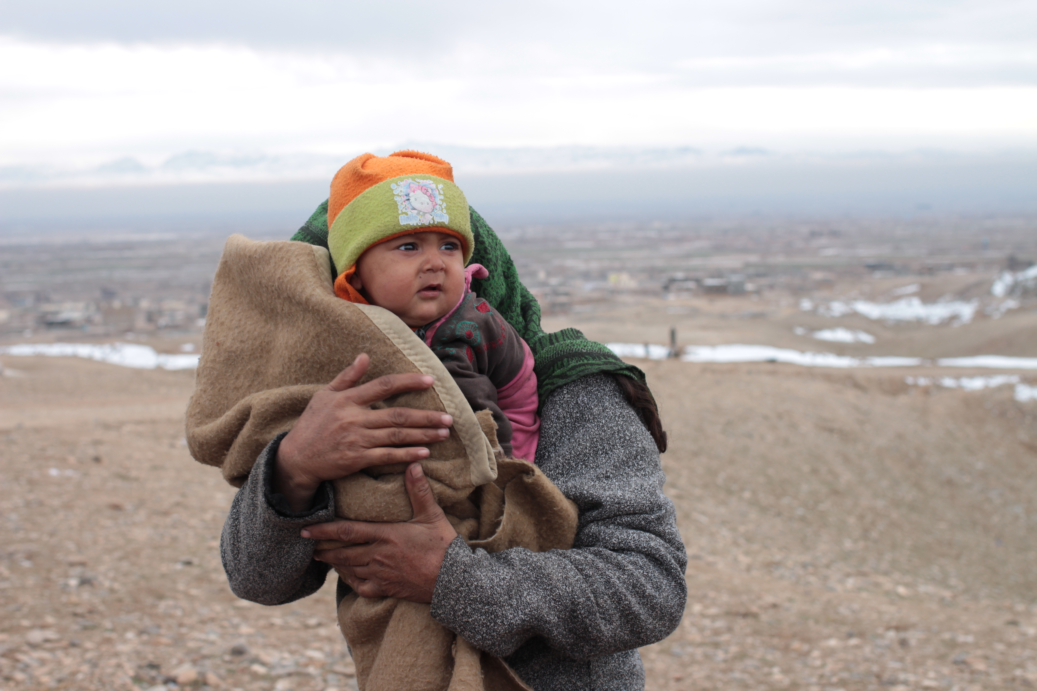 A displaced mother and child on the outskirts of Herat fled several months ago from Ghor province where rain fed crop harvests collapsed due to drought.