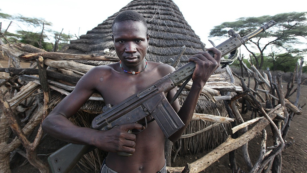 South Sudanese man holding a gun - for generic use