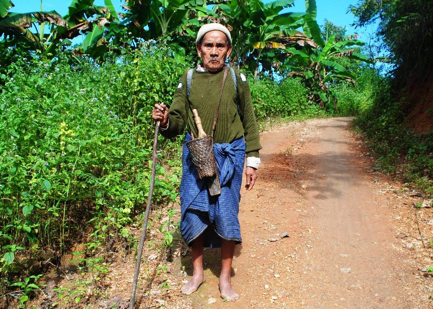 Chin man walking home in Kanpetlet province in Chin State