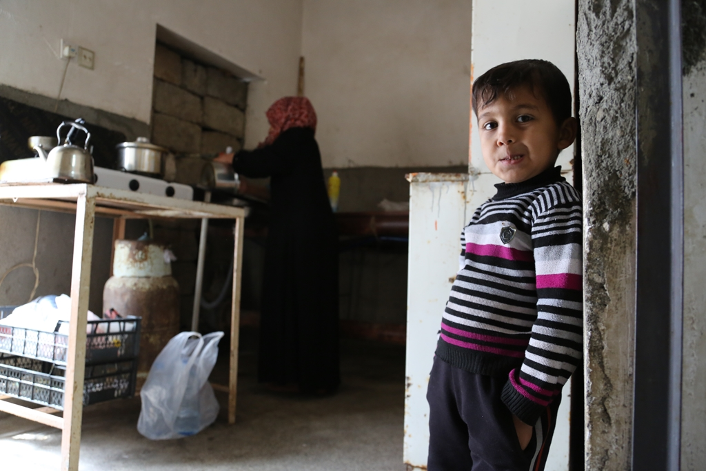 A family displaced from Iraq's Anbar Province now lives in an old warehouse in the northern Kurdistan region. Anbar is home to fighting between Iraqi security forces and militants.