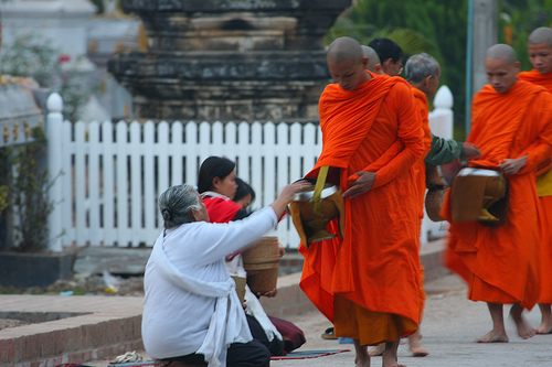 Every morning just after sunrise the monks of Luang Prabang will walk through the city and collect the alms given by people which will provide them with their daily rice.