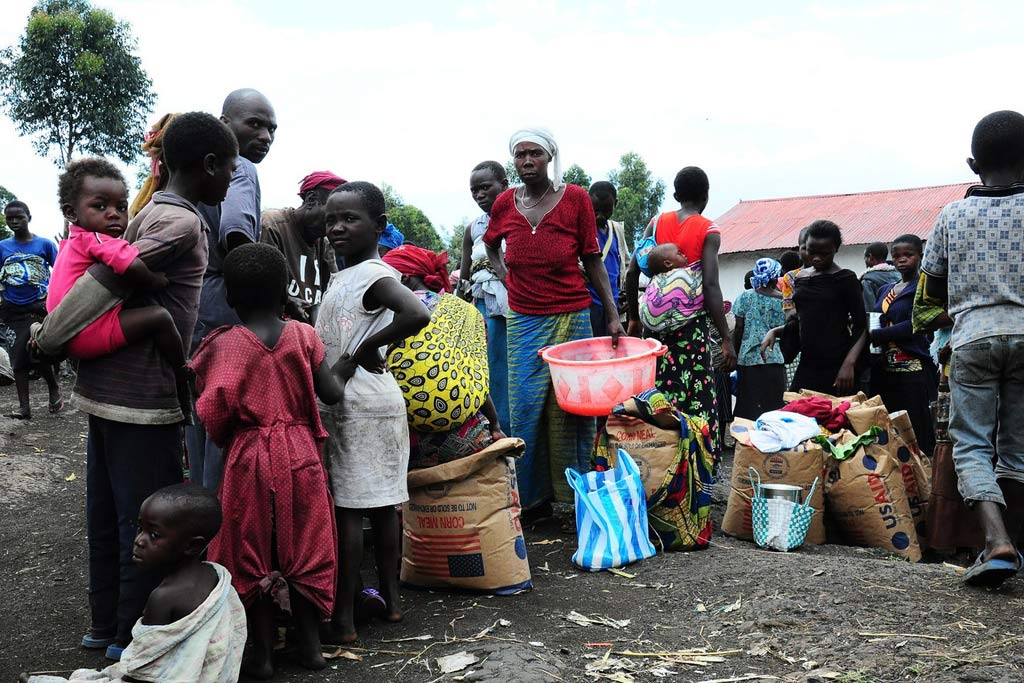 People lining up for food distribution in the Lac Vert IDP site near Goma, North Kivu