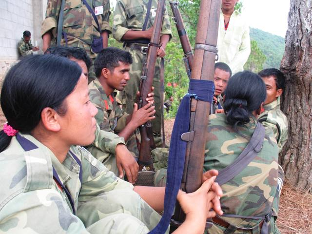 Maoist fighters resting in Nepal. The country's decade-long conflict came to an end in 2006