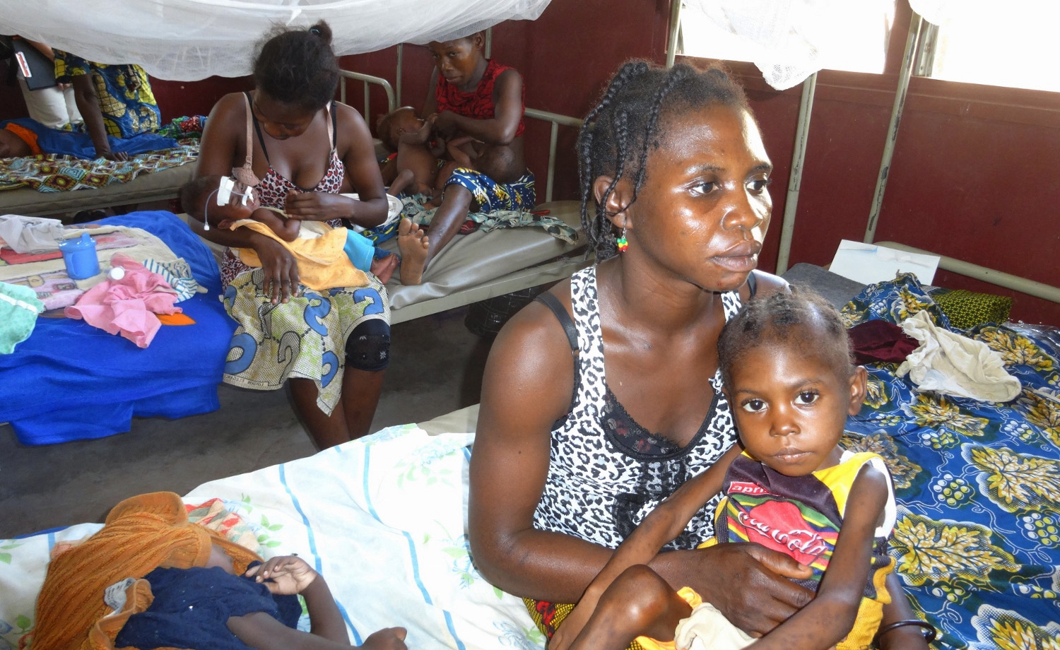 Malnourished child with mother at the Complexe Pediatrique (children's hospital) in Bangui, CAR