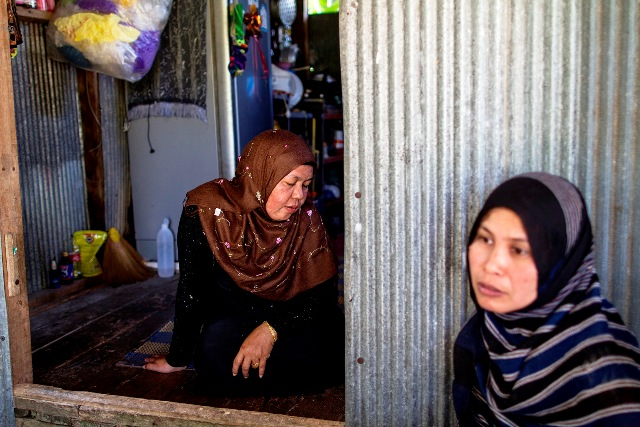 Two women outside their home in southern Thailand. Many women have been impacted by the conflict and in need of social support