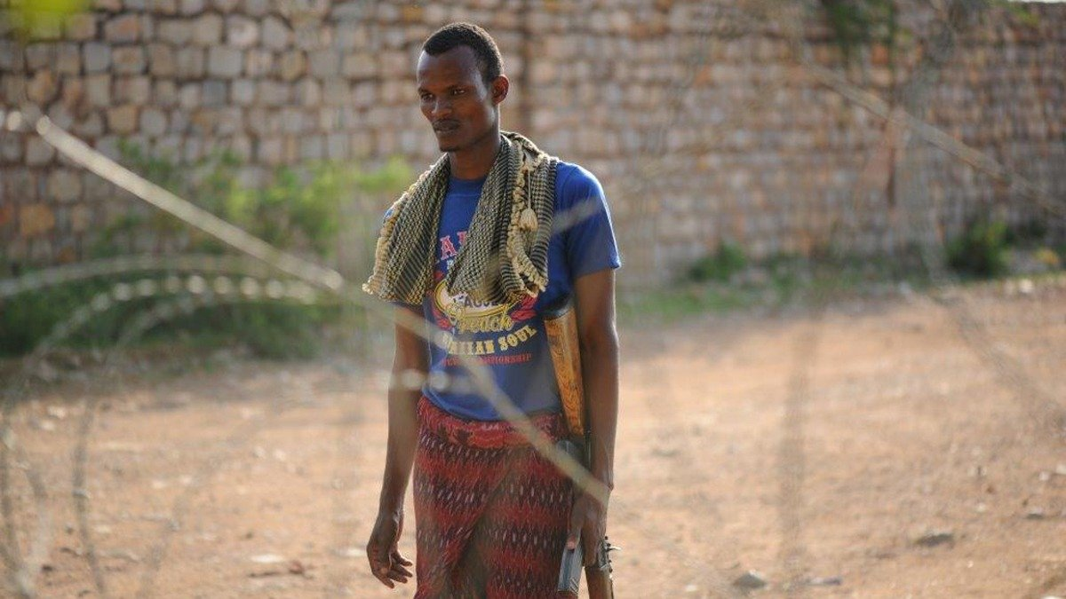 Uniforms for the Somalia National Army are scarce. This soldier wears civilian clothes at the military base in Baidoa
