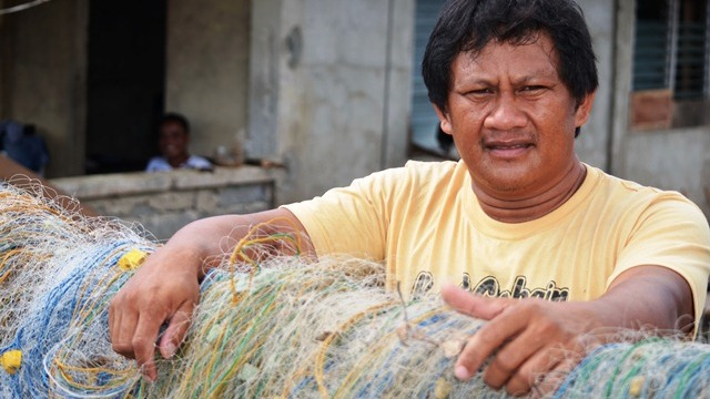A fisherman and his nets in Leyte Province. Close to 150,000 fishermen were badly affected by Typhoon Haiyan, which devastated large parts of the central Philippines on 8 November 2013, and left over 6,000 dead