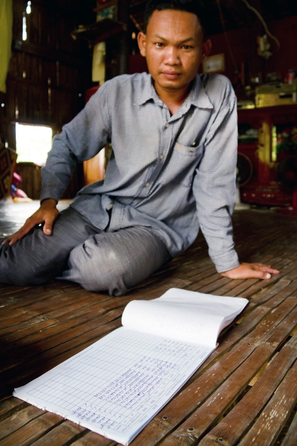 A business owner shows his toilet order log. Accurately documenting latrine transactions makes deliveries faster and more reliable, helps enterprises access formal credit, and assists WaterSHED to monitor the program effectiveness.