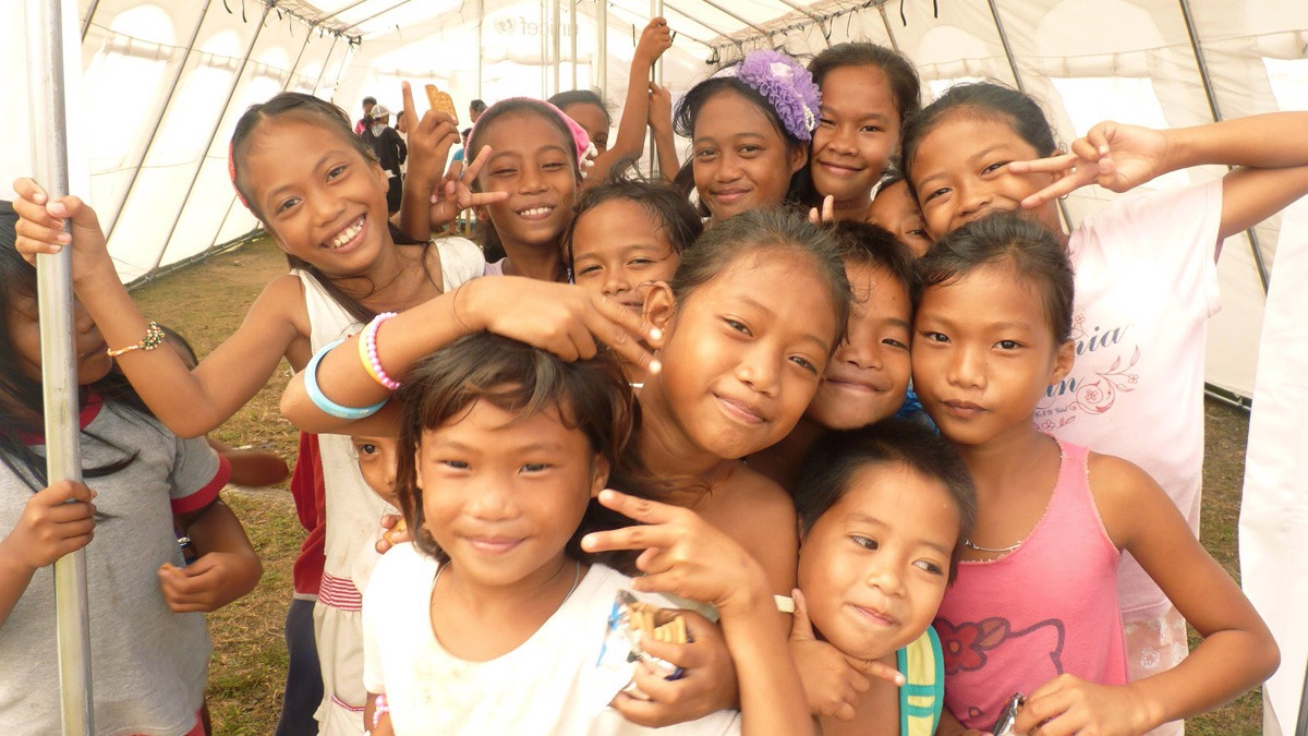 Children inside a temporary learning space in the aftermath of Typhoon Haiyan