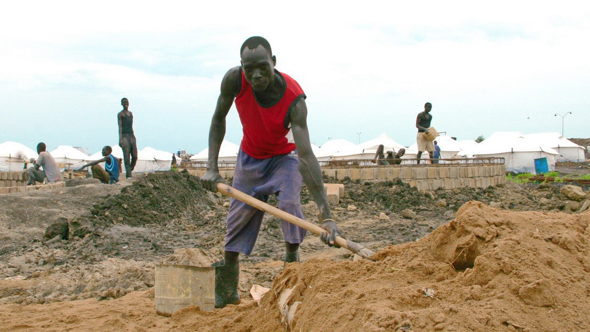 A man shovels sand for a waste-water treatment facility within the new IDP camp at the UN base in Malakal, South Sudan