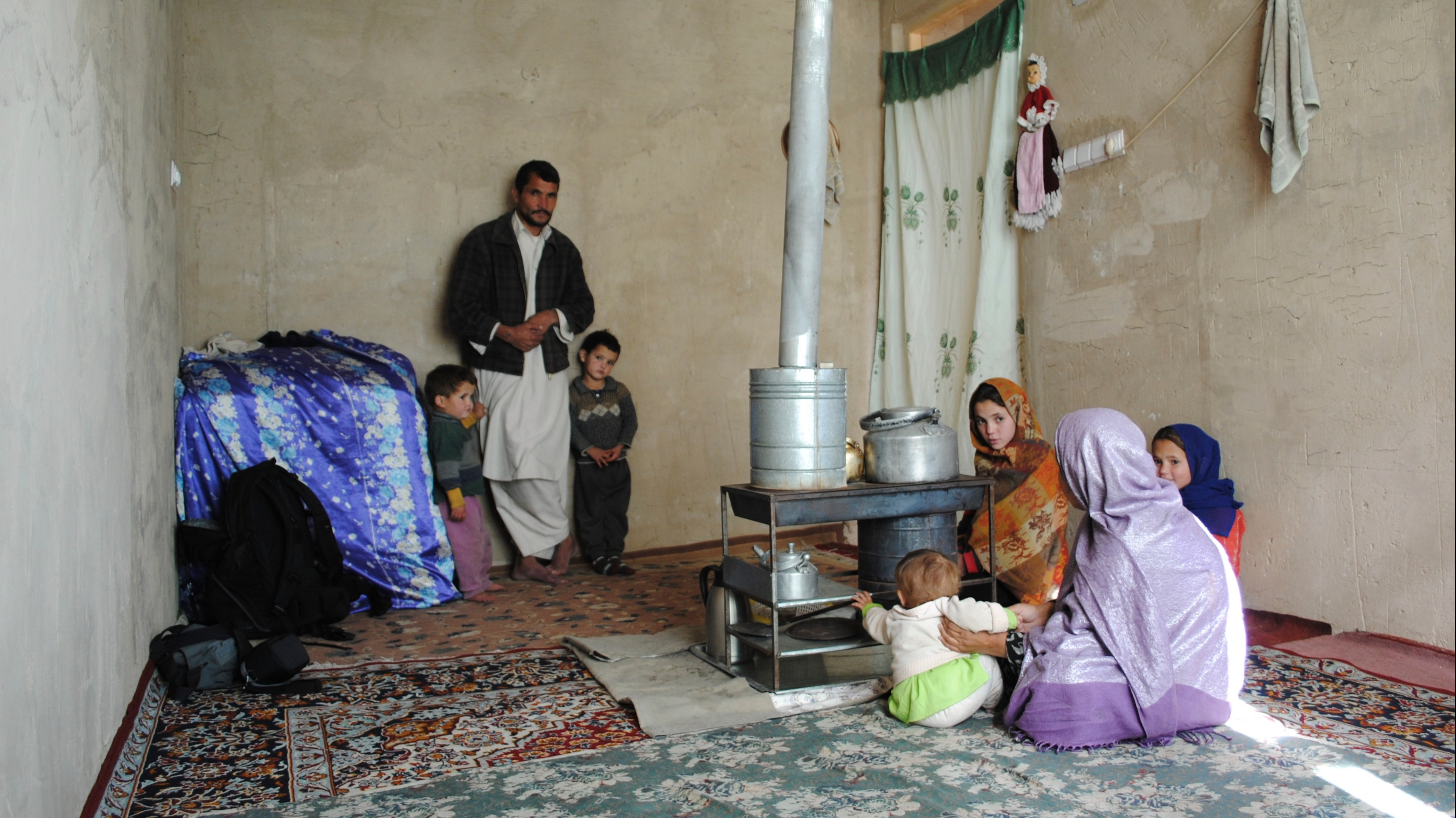 A typical Afghan family living in the capital Kabul. The children are malnourished and have health problems. The father is a laborer, but has trouble finding work and money to feed his family. They have accumulated a large sum of debt. (2011)