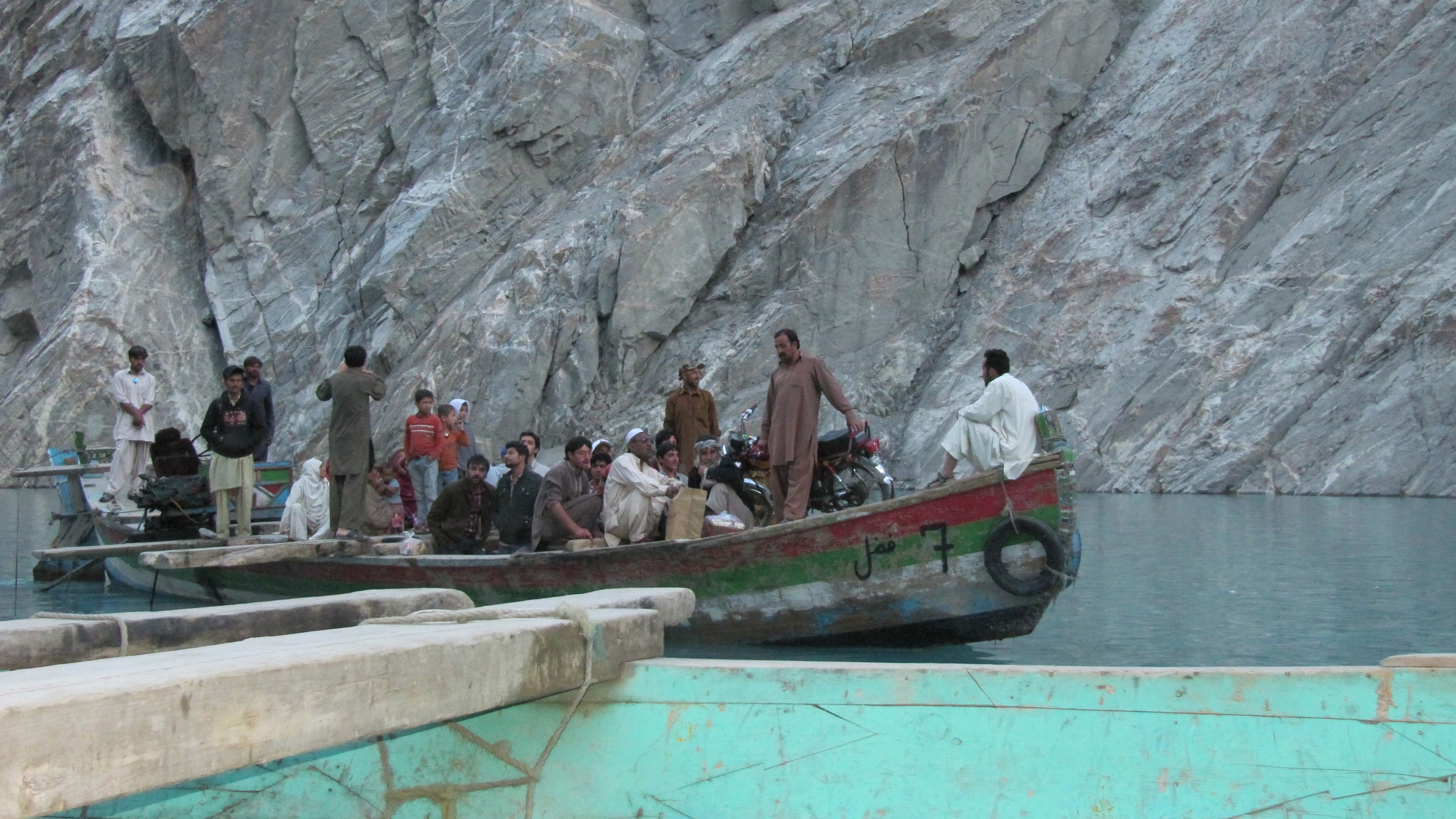 The 21-kilometer Attabad Lake was created by a landslide in 2010. Currently to cross it, goods have to be hauled onto boats.