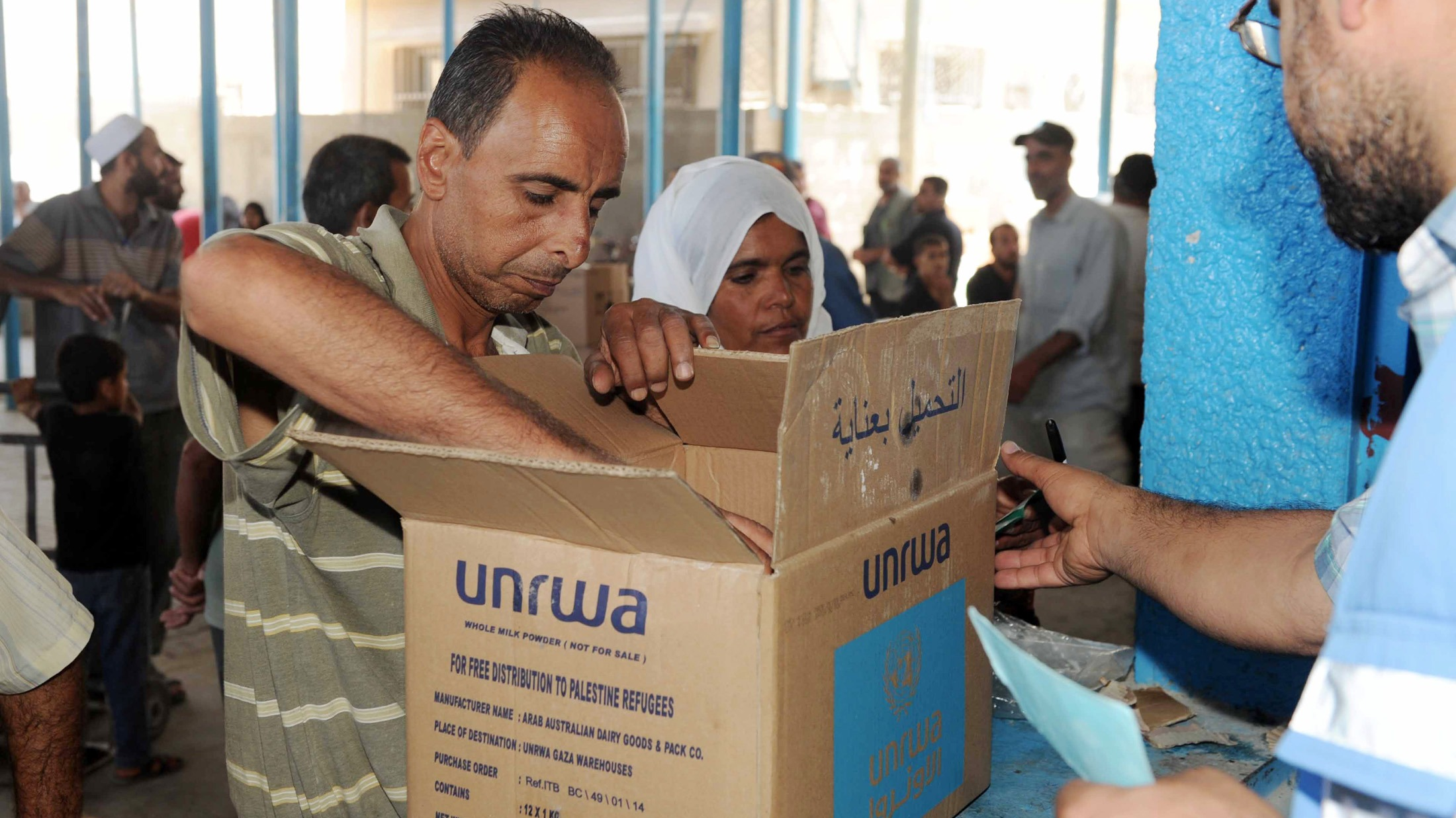 "As part of its regular operations, UNRWA continues to distribute food to 830,000 refugees in Gaza. Beneficiaries at the ""Nuseirat distribution Centre"" collect food items in the Middle Area of the Gaza Strip."