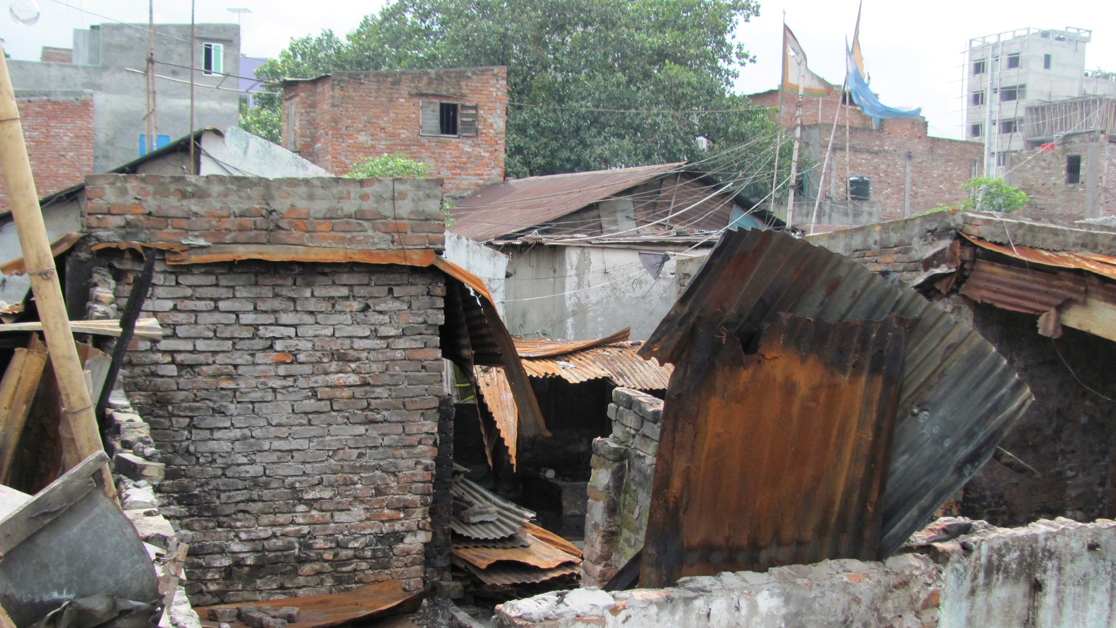 Dozens of homes were torched in June 2014 clashes between Bihari residents and Bengalis that left 10 dead. Biharis, despite some legal progress, live in tenuous arrangements and amid intense stigma in Bangladesh.