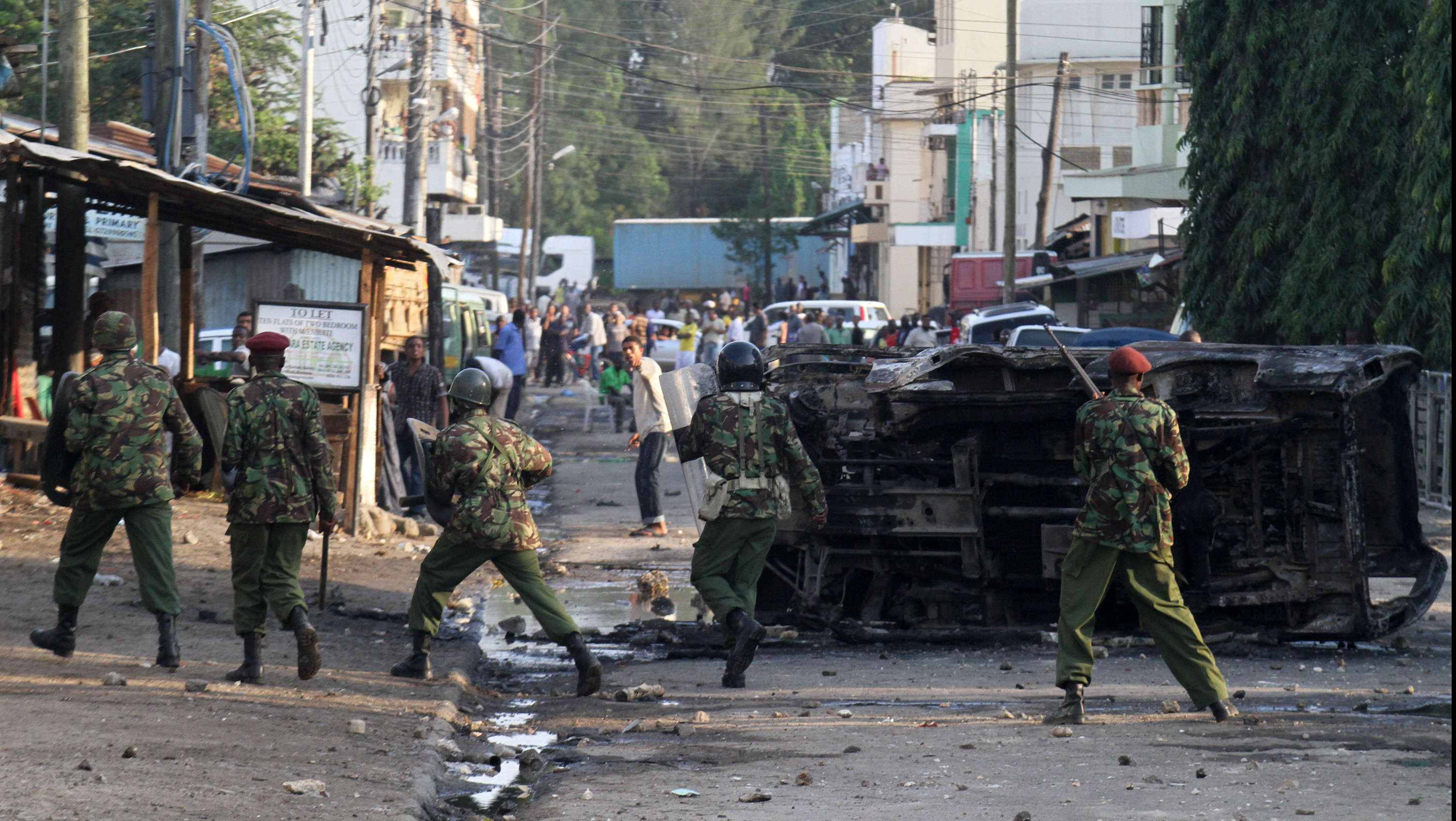 Kenyan security personnel engaging in a street fight with rowdy youths outside the Masjid Musa Mosque in Majengo, Mombasa