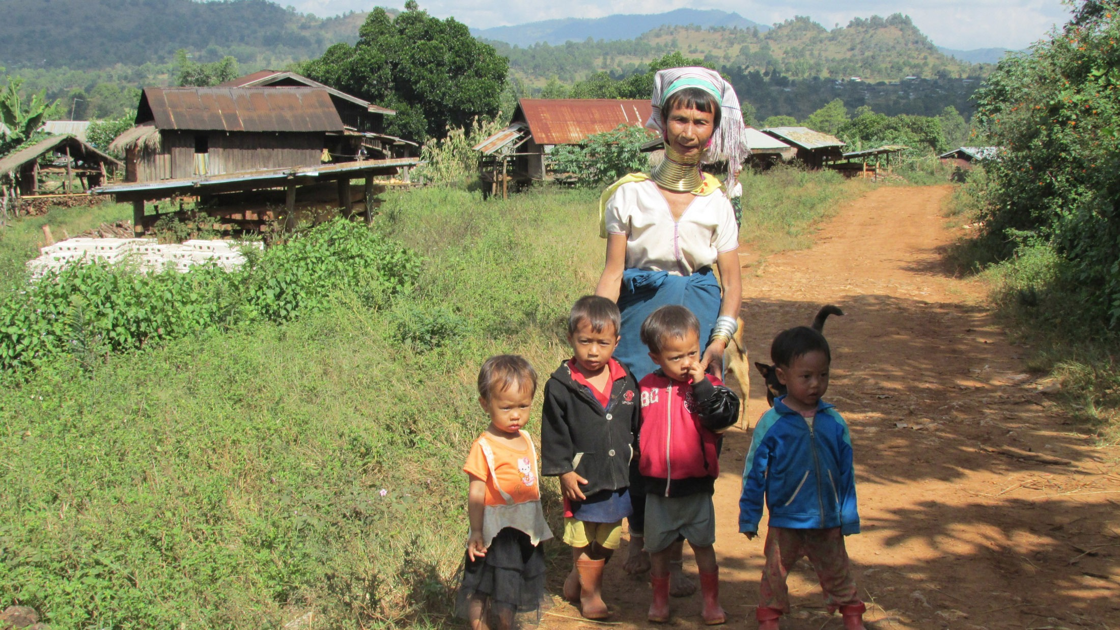 A woman and her children in Myanmar's Kayah state, where peace process negotiations have resulted in a ceasefire but landmine clearance activities remain in limbo.