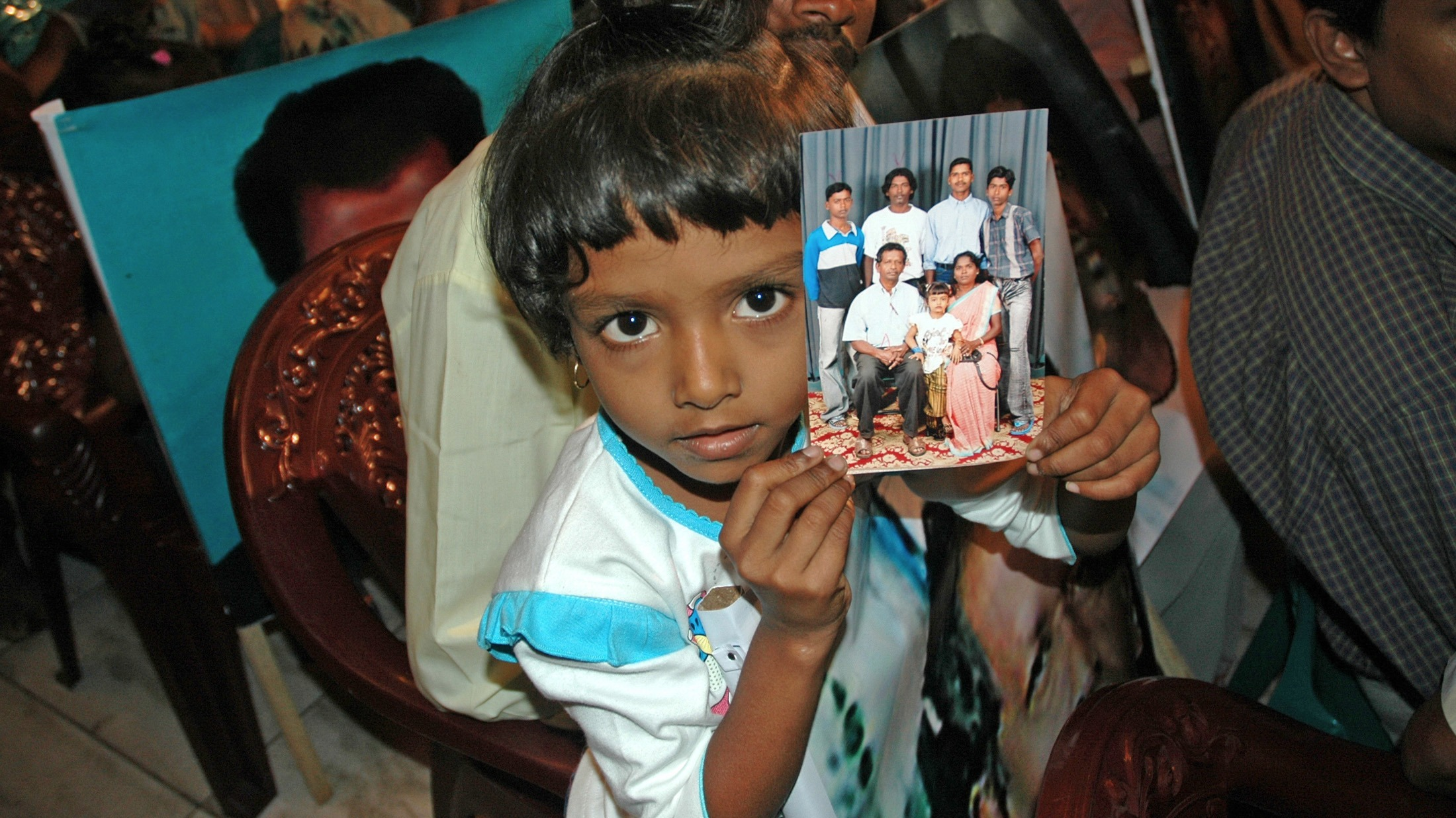 Relatives of missing persons from Sri Lanka's 26-year long civil war hold their pictures during a meeting in Sri Lanka capital Colombo.