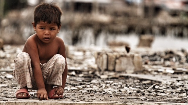 A child at an en evacuation center in Zamboanga city, one year after a deadly Muslim rebel siege