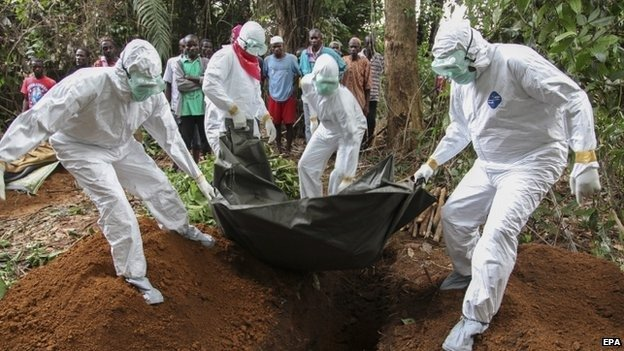 A team trained to bury the bodies of Ebola victims at work in Liberia