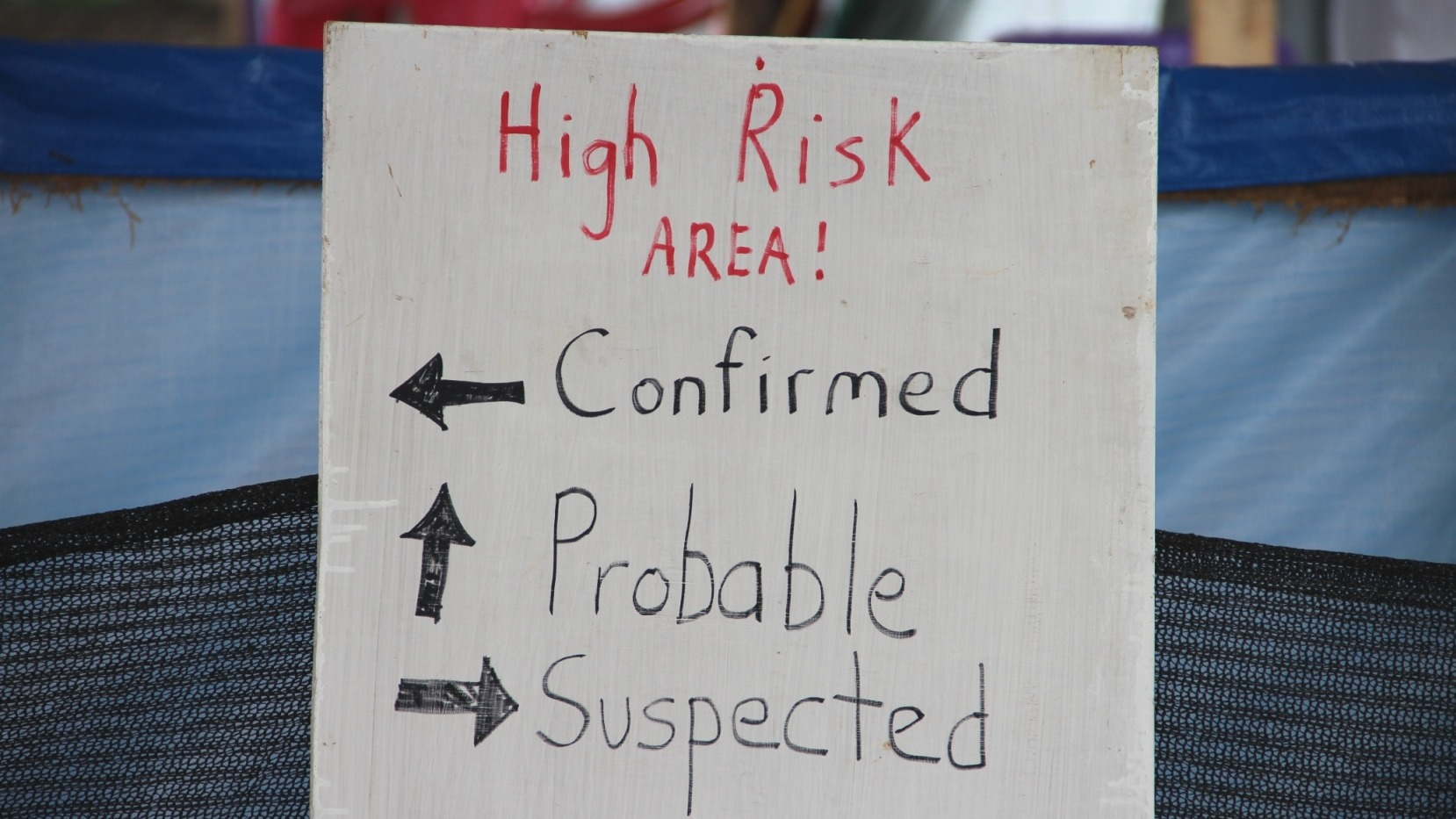 A sign indicating the three wards in the IFRC Ebola Treatment Centre outside of Kenema, Sierra Leone.