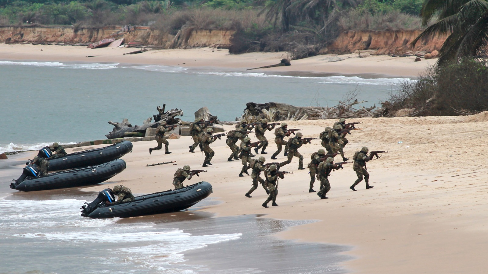 Troops of the Central African Economic Community land on a beach in the Republic of Congo as part of multinational manouevrers